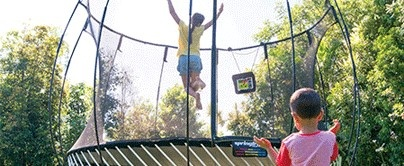 People at any age find joy when playing on a trampoline.